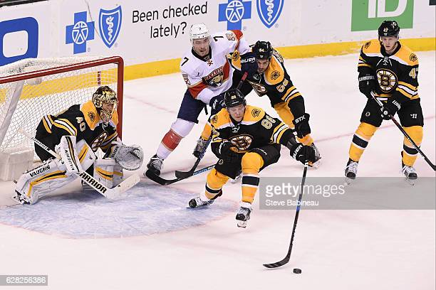 David Pastrnak of the Boston Bruins bats the puck out of the zone against the Florida Panthers at the TD Garden on December 5 2016 in Boston...