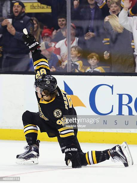 David Pastrnak of the Boston Bruins celebrates after scoring a goal against the Detroit Red Wings during the first period at TD Garden on March 8...