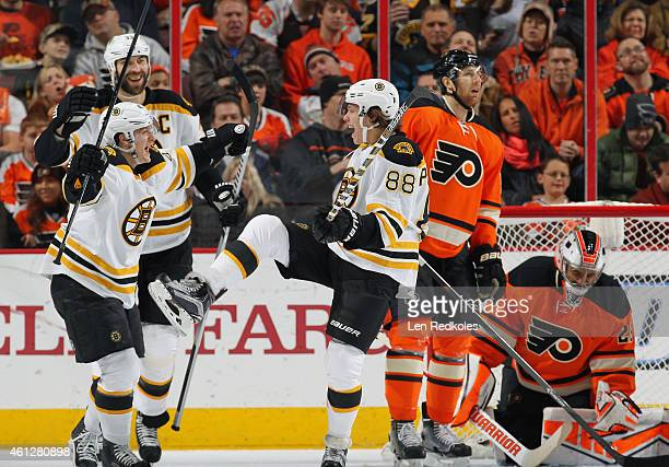 David Pastrnak of the Boston Bruins celebrates his first period power play goal against Braydon Coburn and Ray Emery of the Philadelphia Flyers with...