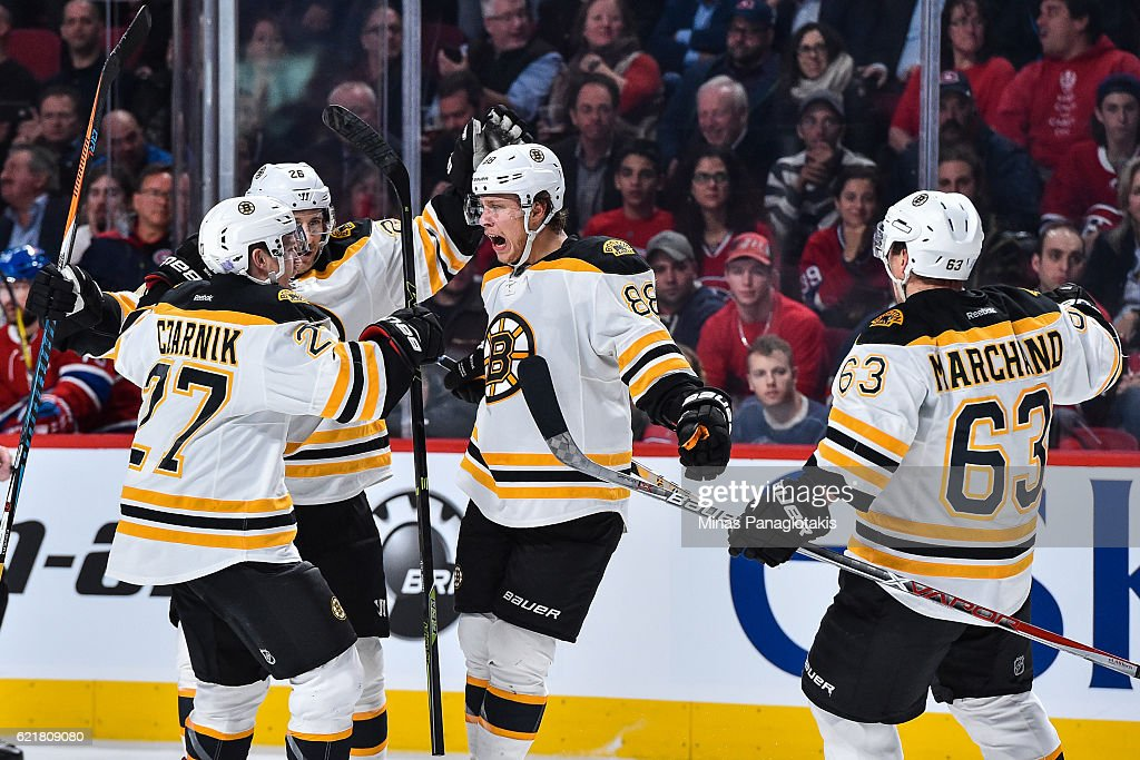David Pastrnak #88 of the Boston Bruins celebrates his third period goal with teammates during the NHL game against the Montreal Canadiens at the Bell Centre on November 8, 2016 in Montreal, Quebec, Canada. The Montreal Canadiens defeated the Boston Bruins 3-2.