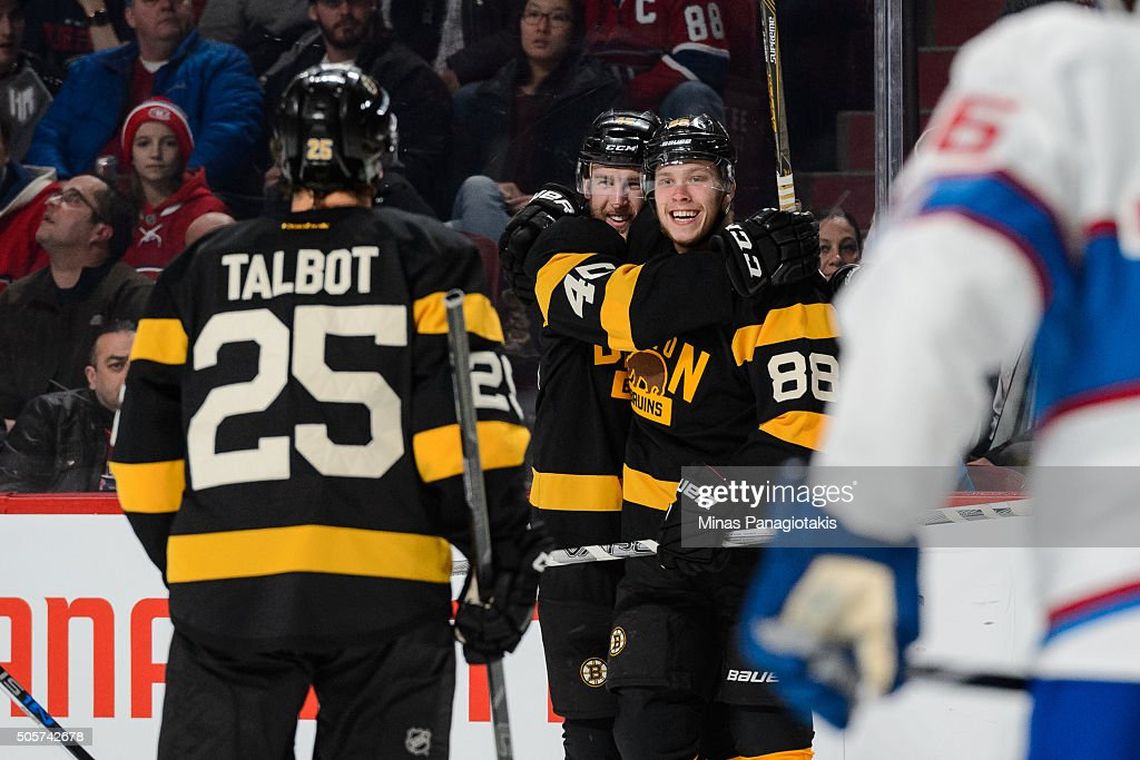 David Pastrnak #88 of the Boston Bruins celebrates his third-period goal with teammates during the NHL game against the Montreal Canadiens at the Bell Centre on January 19, 2016 in Montreal, Quebec, Canada. The Boston Bruins defeated the Montreal Canadiens 4-1.