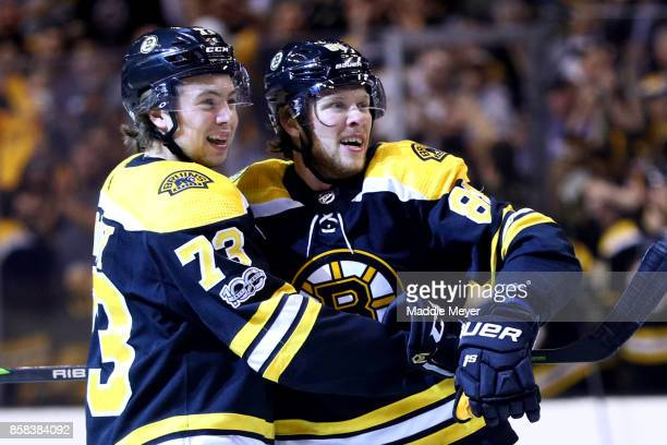 David Pastrnak of the Boston Bruins celebrates with Charlie McAvoy after scoring a goal against the Nashville Predators during the first period at TD...