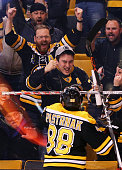 David Pastrnak of the Boston Bruins celebrates with fans after scoring a goal against the Detroit Red Wings during the first period at TD Garden on...