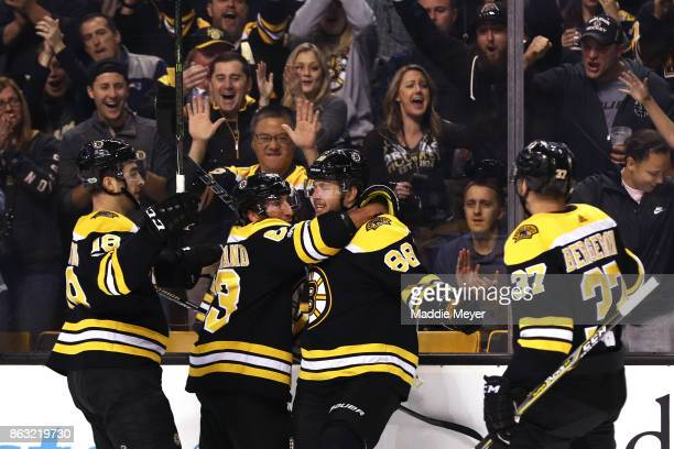 David Pastrnak of the Boston Bruins celebrates with Kenny Agostino Brad Marchand and Patrice Bergeron after scoring a goal against the Vancouver...