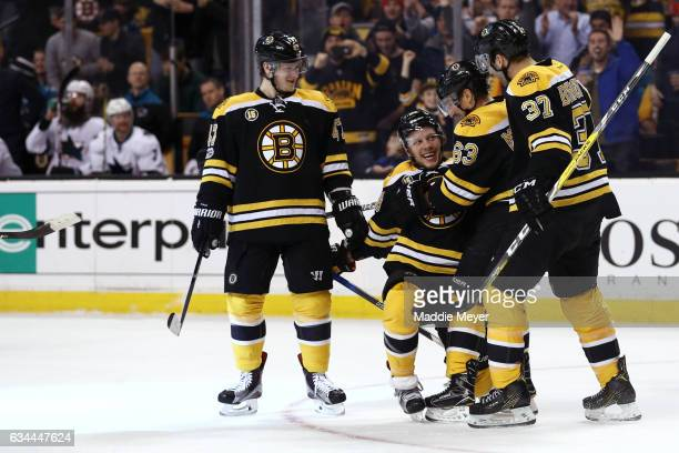 David Pastrnak of the Boston Bruins celebrates with Torey Krug Patrice Bergeron and Brad Marchand after scoring against the San Jose Sharks during...