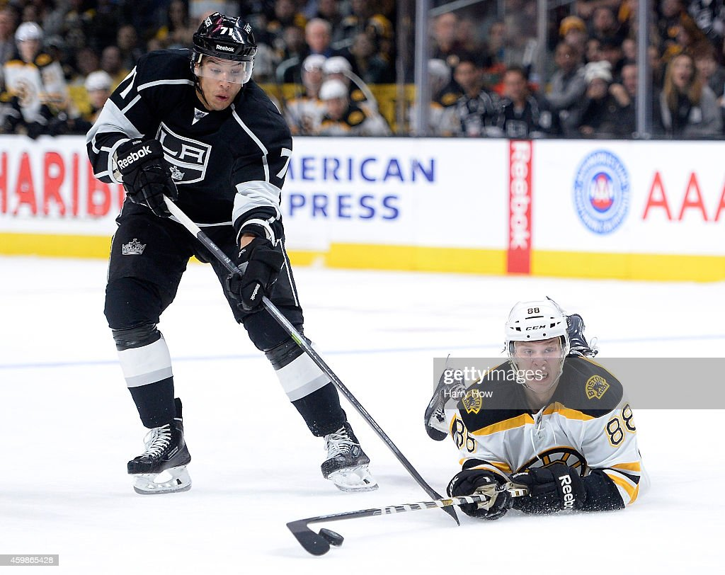 David Pastrnak #88 of the Boston Bruins dives for the puck in front of <a gi-track='captionPersonalityLinkClicked' href=/galleries/search?phrase=Jordan+Nolan&family=editorial&specificpeople=4161890 ng-click='$event.stopPropagation()'>Jordan Nolan</a> #71 of the Los Angeles Kings during the third period at Staples Center on December 2, 2014 in Los Angeles, California. The Kings won 2-0.