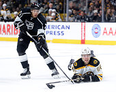 David Pastrnak of the Boston Bruins dives for the puck in front of Jordan Nolan of the Los Angeles Kings during the third period at Staples Center on...
