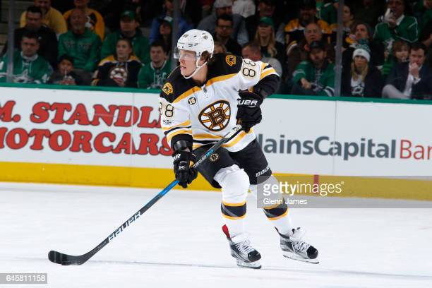 David Pastrnak of the Boston Bruins handles the puck against the Dallas Stars at the American Airlines Center on February 26 2017 in Dallas Texas