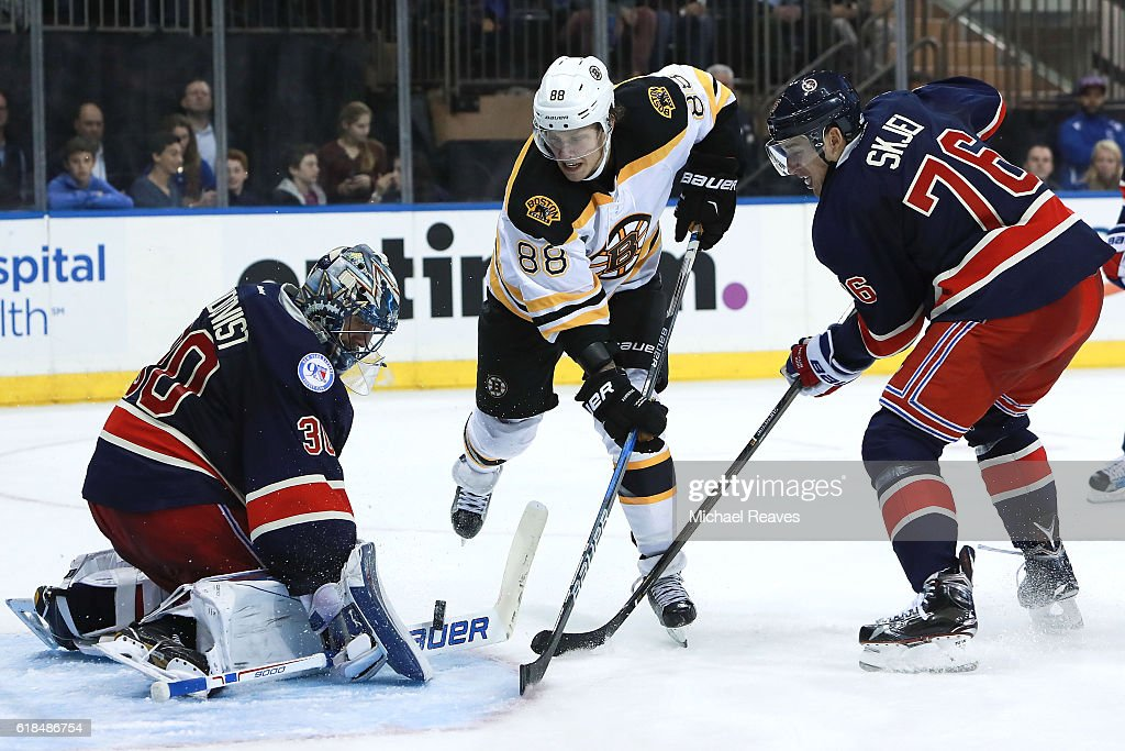 David Pastrnak #88 of the Boston Bruins shoots a shot on Henrik Lundqvist #30 of the New York Rangers defended by Brady Skjei #76 during the third period at Madison Square Garden on October 26, 2016 in New York City.