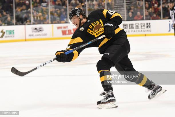 David Pastrnak of the Boston Bruins shoots the puck against the Philadelphia Flyers at the TD Garden on March 11 2017 in Boston Massachusetts