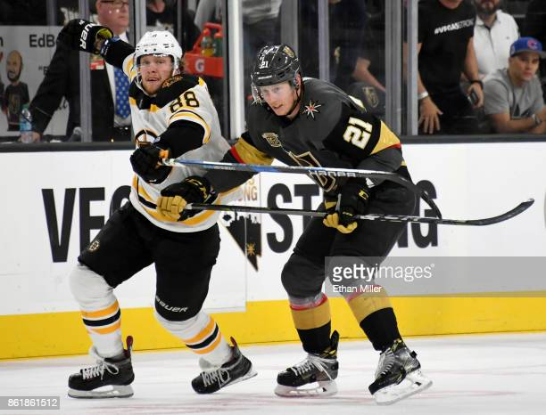 David Pastrnak of the Boston Bruins skates against Cody Eakin of the Vegas Golden Knights in the third period of their game at TMobile Arena on...