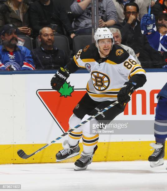 David Pastrnak of the Boston Bruins skates against the Toronto Maple Leafs at the Air Canada Centre on November 10 2017 in Toronto Canada The Maple...