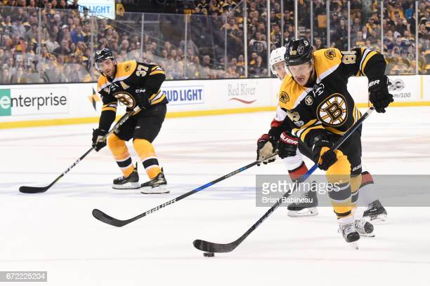 David Pastrnak of the Boston Bruins skates with the puck against the Ottawa Senators in Game Six of the Eastern Conference First Round during the...