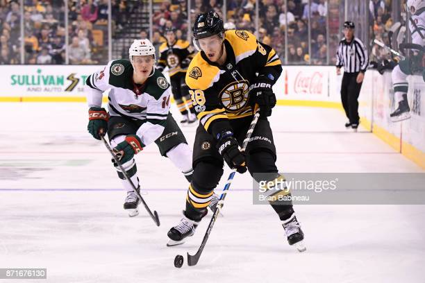David Pastrnak of the Boston Bruins skates with the puck against the Minnesota Wild at the TD Garden on November 6 2017 in Boston Massachusetts