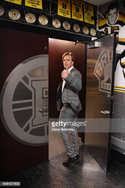 David Pastrnak of the Boston Bruins walks into the locker room before the game against the Arizona Coyotes at the TD Garden on February 28 2017 in...