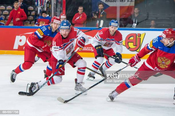 David Pastrnak tries to score against Bogdan Kiselevich during the Ice Hockey World Championship Quarterfinal between Russia and Czech Republic at...