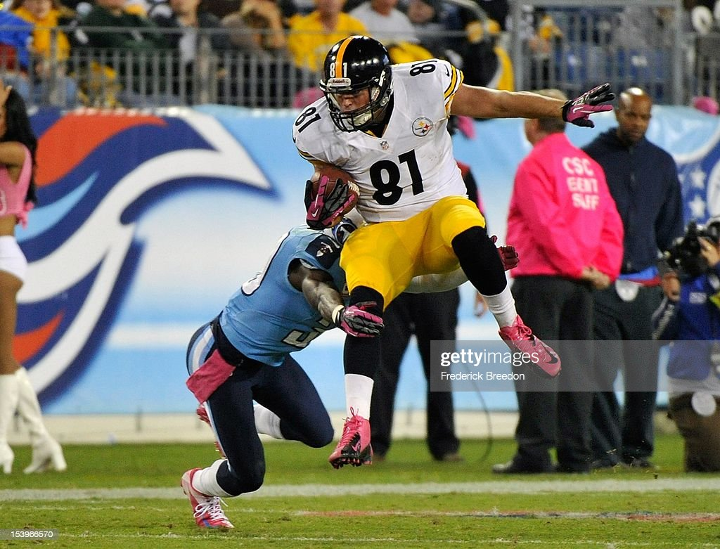 David Paulson #81 of the Pittsburgh Steelers is tackled by a Tennessee Titan at LP Field on October 11, 2012 in Nashville, Tennessee.