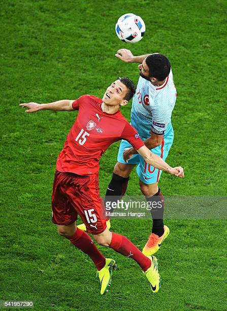 David Pavelka of Czech Republic challenges Arda Turan of Turkey in the air for the ball during the UEFA EURO 2016 Group D match between Czech...