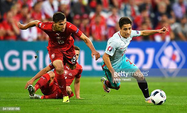 David Pavelka of Czech Republic runs after Emre Mor of Turkey during the UEFA EURO 2016 Group D match between Czech Republic and Turkey at Stade...