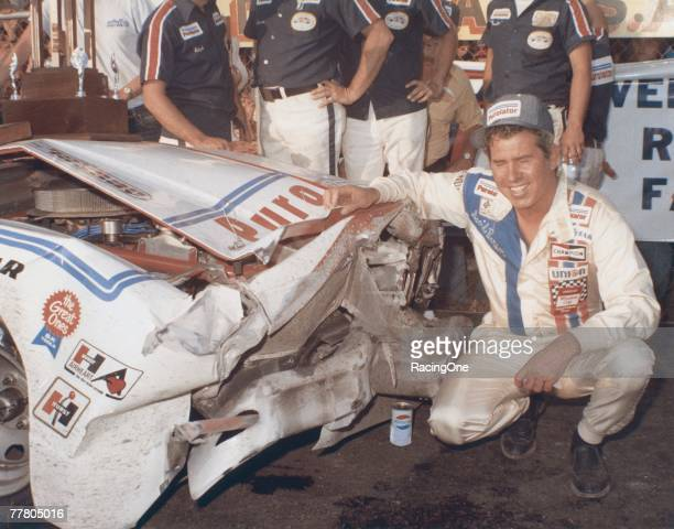 David Pearson driver of the Wood Brothers Mercury celebrates in victory lane after winning the 1976 Winston Cup Daytona 500 at the Daytona...