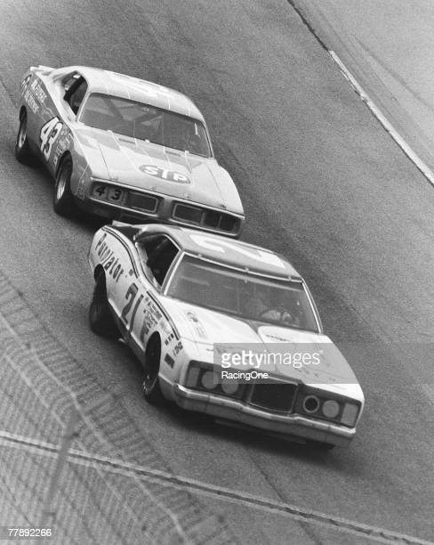 David Pearson leads a storming Richard Petty for a onecarlength victory in the 1974 Daytona Firecracker 400 on July 4 1974 in Daytona Beach Florida...