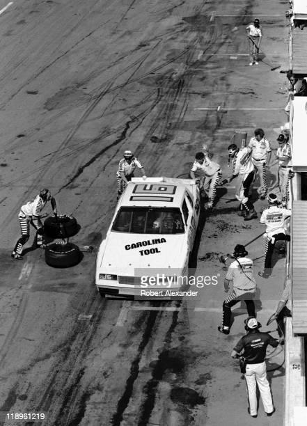 David Pearson makes a pit stop during the 1984 Daytona 500 on February 19 1984 at the Daytona International Speedway in Daytona Beach Florida