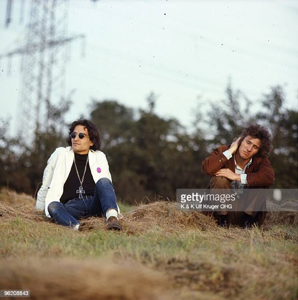 David Peel and American singersongwriter Tim Buckley sit on a grass verge in September 1968 in Germany