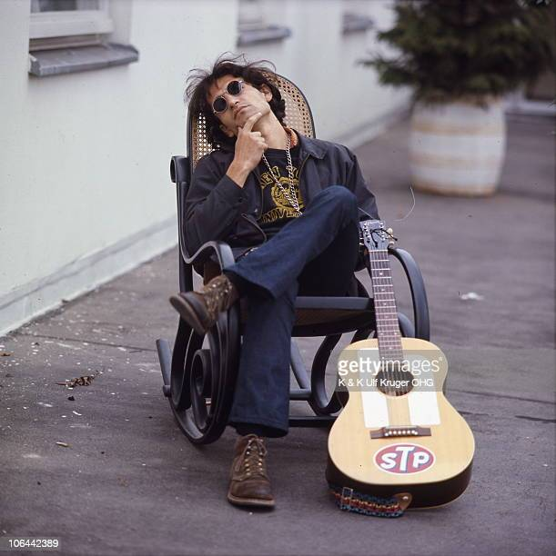 David Peel poses for a portrait with his acoustic guitar circa 1968 in Germany