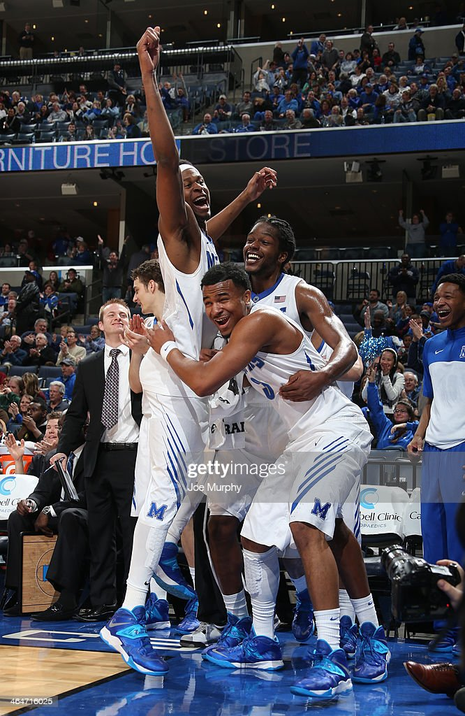 David Pellom #12, Shaq Goodwin #2 and Chris Crawford #3 and of the Memphis Tigers celebrate from the bench against the Houston Cougars on January 23, 2014 at FedExForum in Memphis, Tennessee. Memphis beat Houston 82-59.