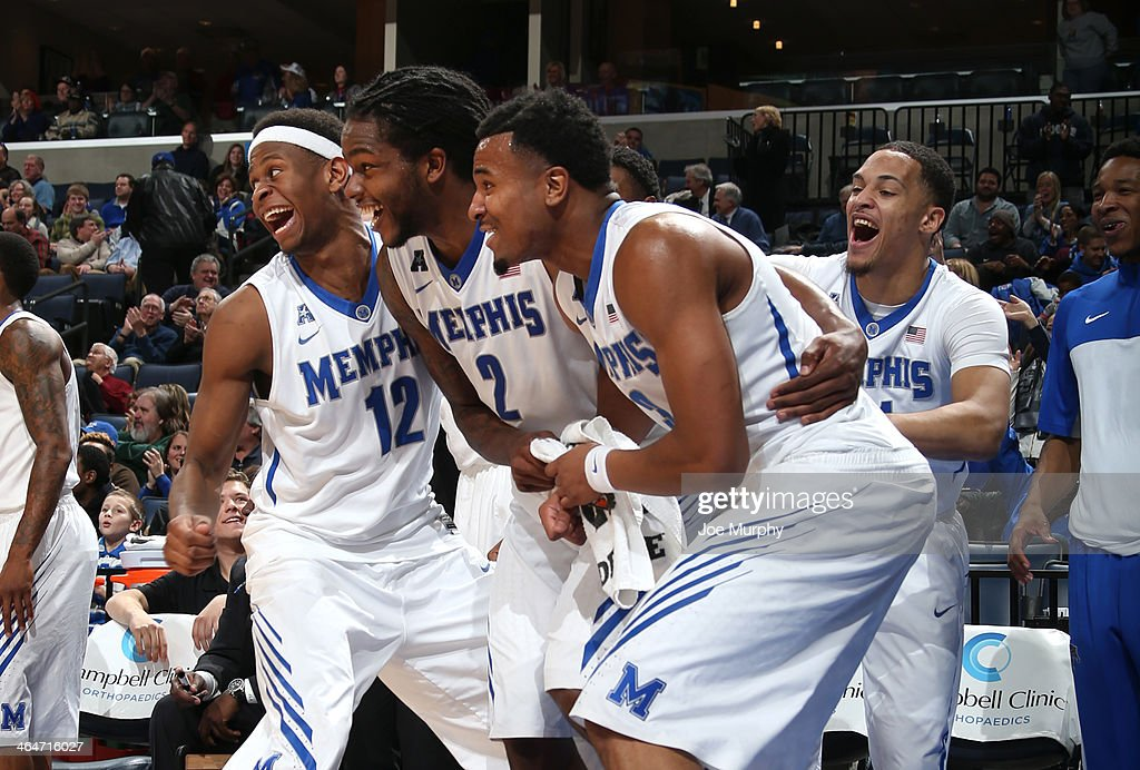 David Pellom #12, Shaq Goodwin #2, Chris Crawford #3 and Michael Dixon Jr. #11 of the Memphis Tigers celebrate from the bench against the Houston Cougars on January 23, 2014 at FedExForum in Memphis, Tennessee. Memphis beat Houston 82-59.