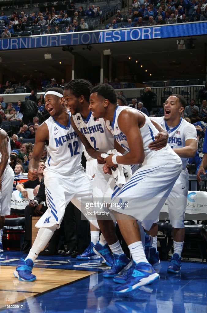 David Pellom #12, Shaq Goodwin #2, Chris Crawford #3 and Michael Dixon Jr. #11 of the Memphis Tigers celebrate against the Houston Cougars on January 23, 2014 at FedExForum in Memphis, Tennessee. Memphis beat Houston 82-59.