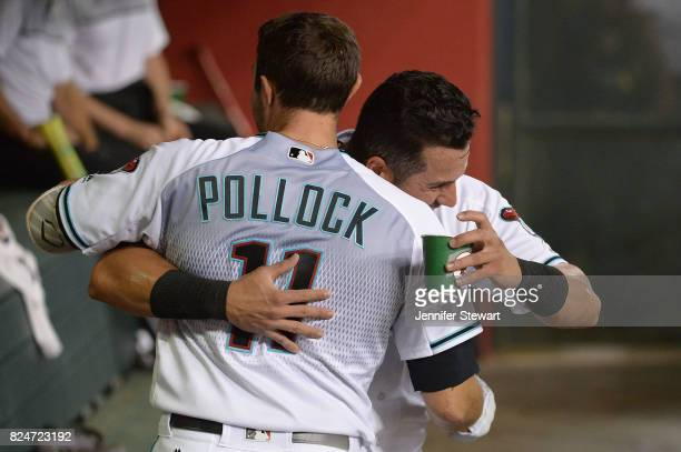 David Peralta and AJ Pollock of the Arizona Diamondbacks hug in the dugout during the first inning of the MLB game against the Washington Nationals...