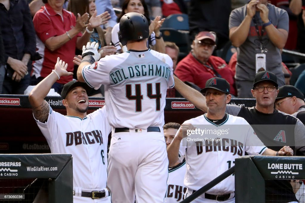 David Peralta #6 and manager Torey Lovullo #17 of the Arizona Diamondbacks high five Paul Goldschmidt #44 after hitting a solo home run against the San Diego Padres during the first inning of the MLB game at Chase Field on April 25, 2017 in Phoenix, Arizona.