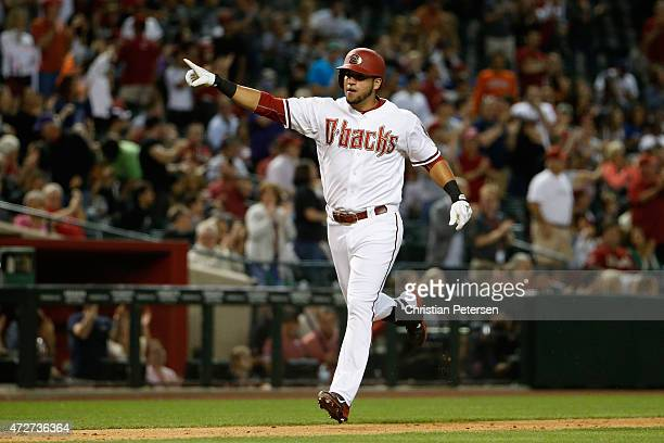 David Peralta of the Arizona Diamondbacks celebrates as he rounds the bases after hitting a solo home run against the San Diego Padres during the...