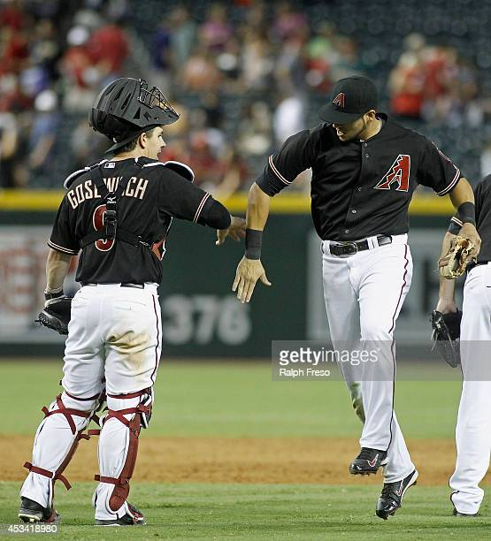 David Peralta of the Arizona Diamondbacks celebrates with his teammate Tuffy Gosewisch following a 144 win over the Colorado Rockies during a MLB...