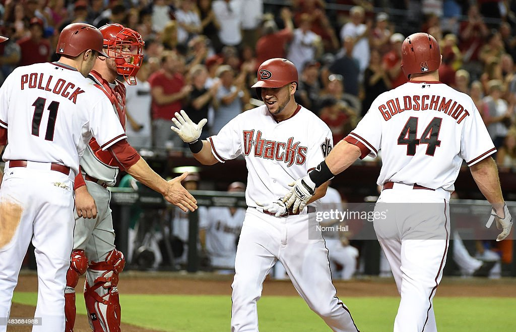 David Peralta of the Arizona Diamondbacks celebrates with teammates AJ Pollock and Paul Goldschmidt after hitting a second inning grand slam home run...