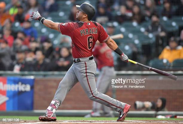David Peralta of the Arizona Diamondbacks hits a sacrifice fly scoring AJ Pollock against the San Francisco Giants in the top of the first inning at...