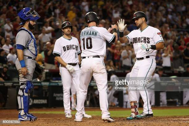 David Peralta of the Arizona Diamondbacks is congratulated by Chris Herrmann and AJ Pollock after hititng a tworun home run against the Chicago Cubs...