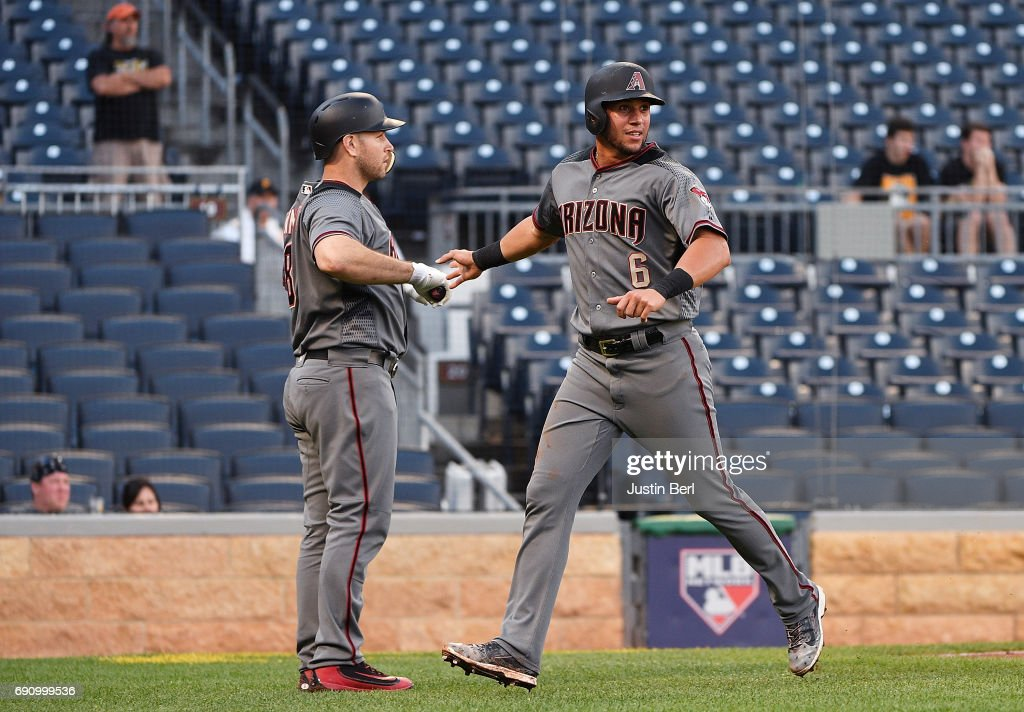 David Peralta #6 of the Arizona Diamondbacks is greeted by Chris Iannetta #8 after scoring on an RBI single by Chris Owings in the 14th inning during the game against the Pittsburgh Pirates at PNC Park on May 31, 2017 in Pittsburgh, Pennsylvania.