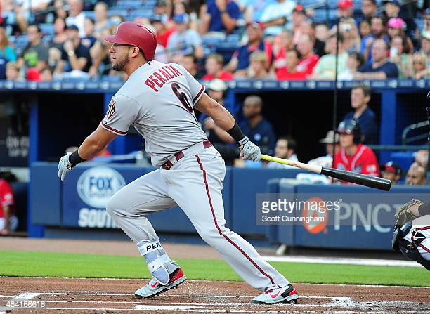 David Peralta of the Arizona Diamondbacks knocks in a run with a first inning single against the Atlanta Braves at Turner Field on August 15 2015 in...