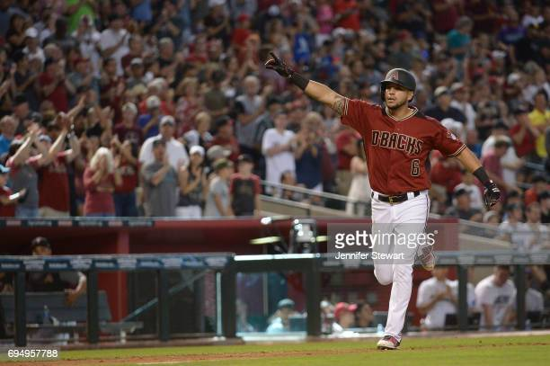David Peralta of the Arizona Diamondbacks points to the stands after hitting a two run homer in the seventh inning against the Milwaukee Brewers at...