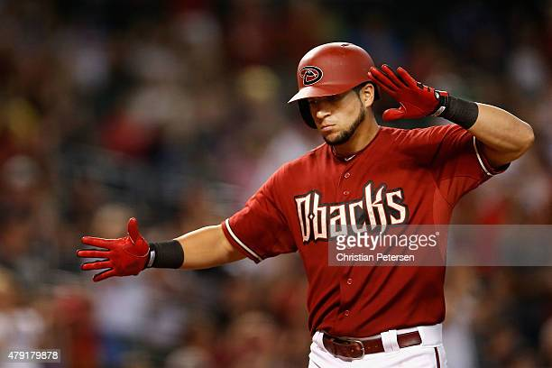 David Peralta of the Arizona Diamondbacks reacts after hitting a solo home run against the Los Angeles Dodgers during the ninth inning of the MLB...