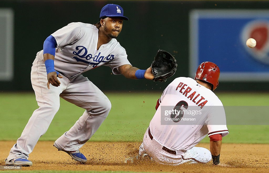 <a gi-track='captionPersonalityLinkClicked' href=/galleries/search?phrase=David+Peralta&family=editorial&specificpeople=9681543 ng-click='$event.stopPropagation()'>David Peralta</a> #6 of the Arizona Diamondbacks safely slides into second base ahead of infielder <a gi-track='captionPersonalityLinkClicked' href=/galleries/search?phrase=Hanley+Ramirez&family=editorial&specificpeople=538406 ng-click='$event.stopPropagation()'>Hanley Ramirez</a> #13 of the Los Angeles Dodgers during the fifth inning of the MLB game at Chase Field on August 26, 2014 in Phoenix, Arizona.