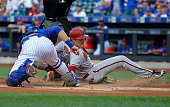 David Peralta of the Arizona Diamondbacks slides in safely with a run before catcher Kevin Plawecki of the New York Mets can make the tag on a...