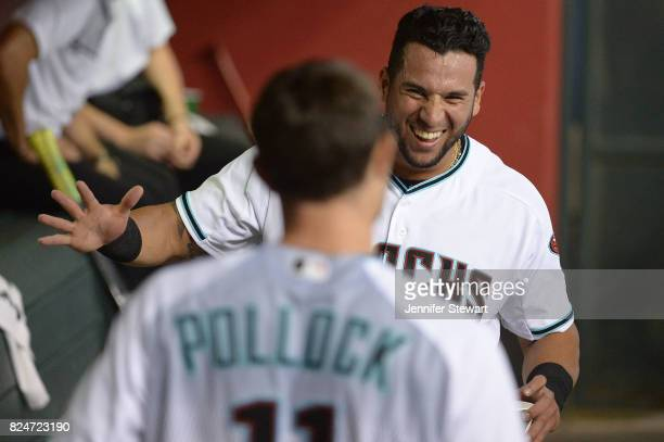 David Peralta of the Arizona Diamondbacks smiles after teammate AJ Pollock hits a solo home run during the first inning of the MLB game against the...