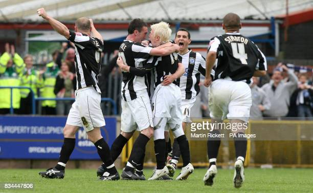 David Perkins celebrates his goal with Rory McArdle during the CocaCola League Two Play Off Semi Final Second Leg match at Spotland Rochdale