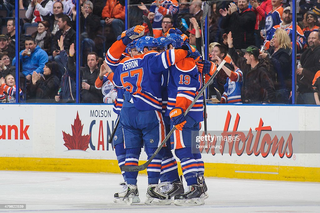 David Perron #57 and Justin Schultz #19 of the Edmonton Oilers celebrate the goal of Taylor Hall (not pictured) against the Buffalo Sabres during an NHL game at Rexall Place on March 20, 2014 in Edmonton, Alberta, Canada.