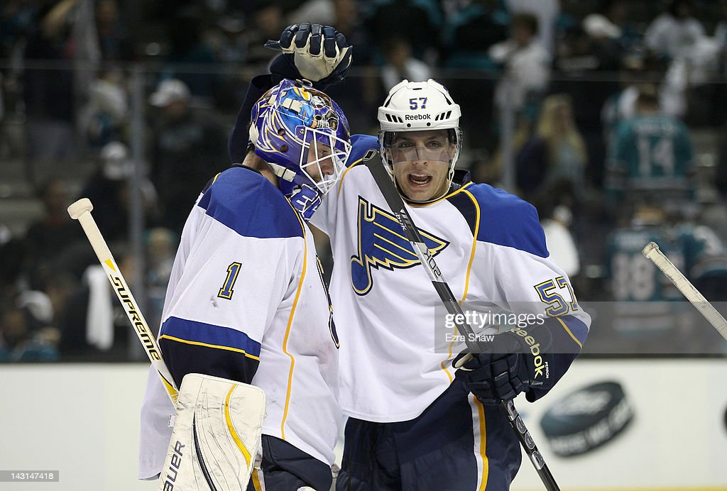 David Perron #57 congratulates Brian Elliott #1 of the St. Louis Blues after they beat the San Jose Sharks in Game Four of the Western Conference Quarterfinals during the 2012 NHL Stanley Cup Playoffs at HP Pavilion on April 19, 2012 in San Jose, California.