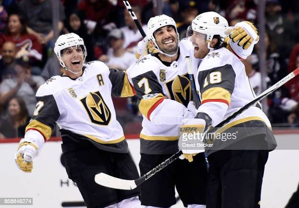 David Perron Jason Garrison and James Neal of the Vegas Golden Knights celebrate the gamewinning goal against the Arizona Coyotes at Gila River Arena...