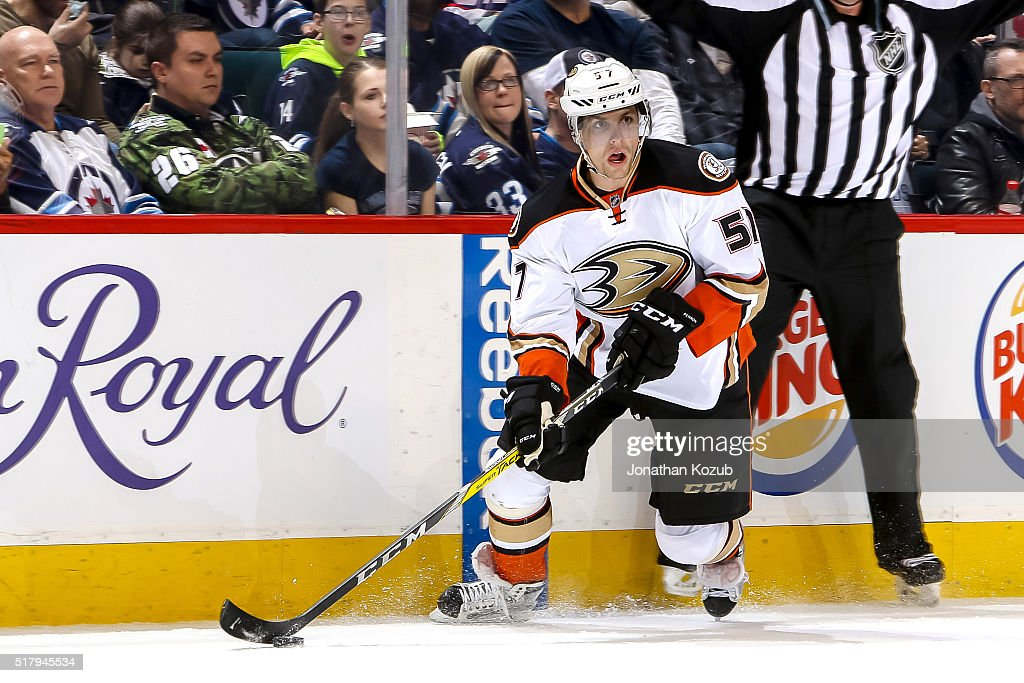 David Perron of the Anaheim Ducks plays the puck down the ice during first period action against the Winnipeg Jets at the MTS Centre on March 20 2016...